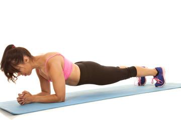fitness woman pink sports bra low plank