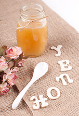 Jar with honey and spoon