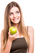 Portrait of a young woman eating green apple