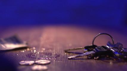 Keys and money laying around, horizontal