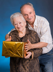 A grown son and aging mom with present box
