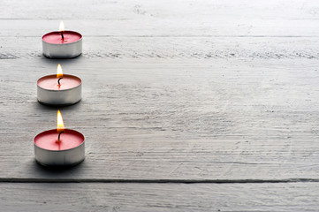 Burning red tealight candles