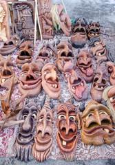 wooden carved funny masks market fair rural crafts