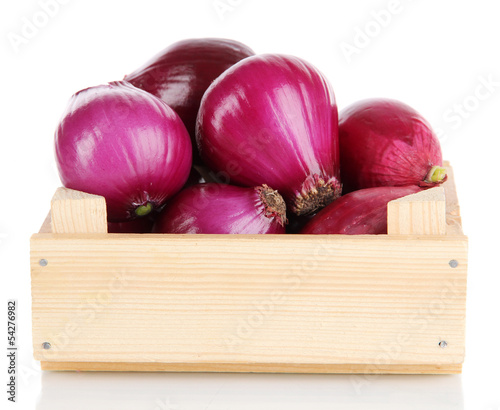 Purple onion in wooden box isolated on white