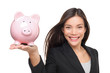 Businesswoman holding piggy bank - savings concept