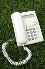 White desktop phone in the field.