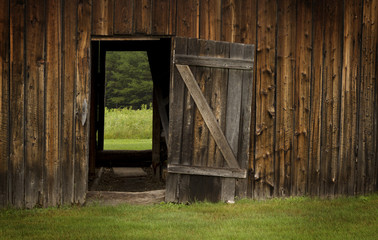barn door open on green landscape