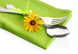 spoon, fork and flower on napkin, isolated on white