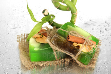 Hand-made soap and bamboo with drops, close up
