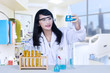 Beautiful female doctor analysing chemical in hospital