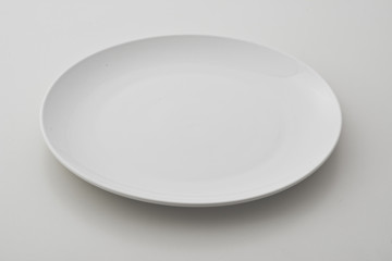 round porcelain plates on white background