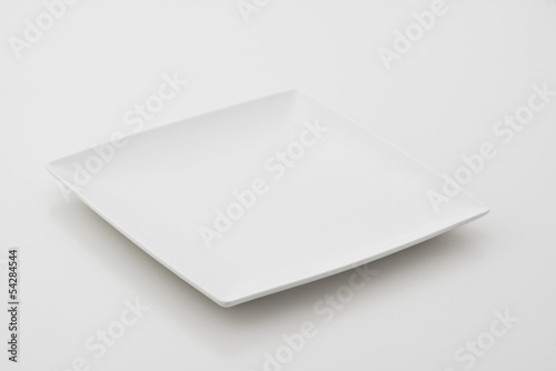Porcelain plates on white background
