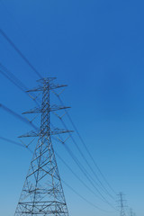 high voltage post with blue sky
