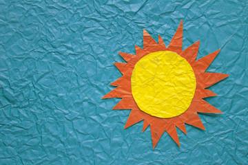 Sun on crumpled paper