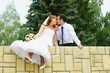 wedding couple kiss and dangle feet. Tenderness loving