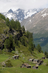 Dom and Taschhorn above chalets in Swiss Alps