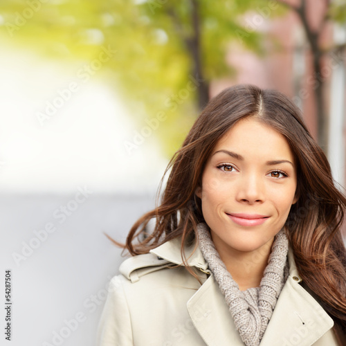 Autumn fall woman lifestyle portrait in the city street