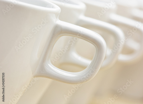 White cups with handles