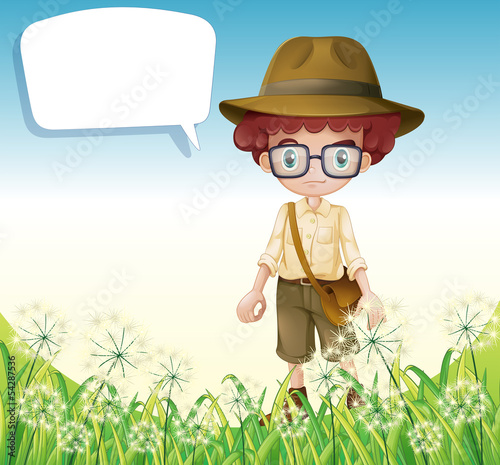 A boy standing near the grass with an empty callout