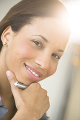 Beautiful Businesswoman Smiling With Hand On Chin
