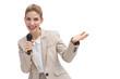 Gesturing businesswoman speaking on microphone