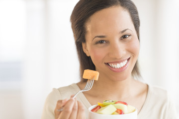 Beautiful Woman With Fruit Salad At Home