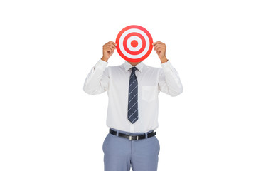 Businessman hiding his face behind a red target