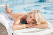 Sun tanning. Beautiful young women in bikini lying on the deck c