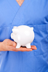 Doctor Holding Piggy Bank Abstract