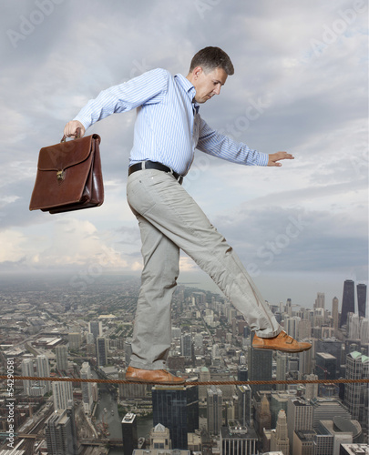 Businessman keeping his balance