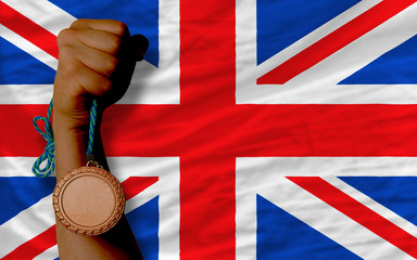 Bronze medal for sport and  national flag of united kingdom