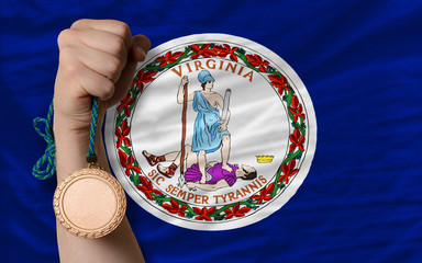 Bronze medal for sport and  flag of american state of virginia