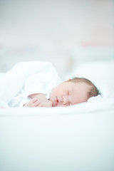 Newborn Baby Laying on White Bed