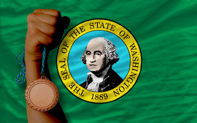 Bronze medal for sport and  flag of american state of washington