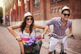 Fototapety Couple riding bicycles in the city