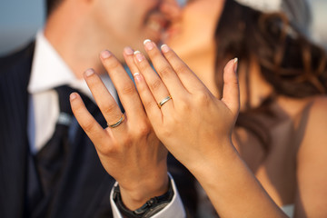 Closeup of hands of newlyweds showing their rings