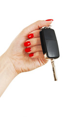 A woman's hand holds car keys on white background
