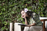 Beautiful girl reading a book in garden