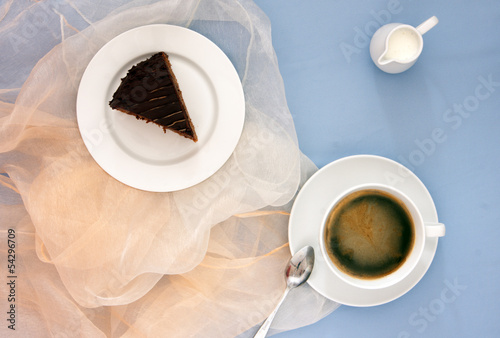 Chocolate sacher cake on a blue background