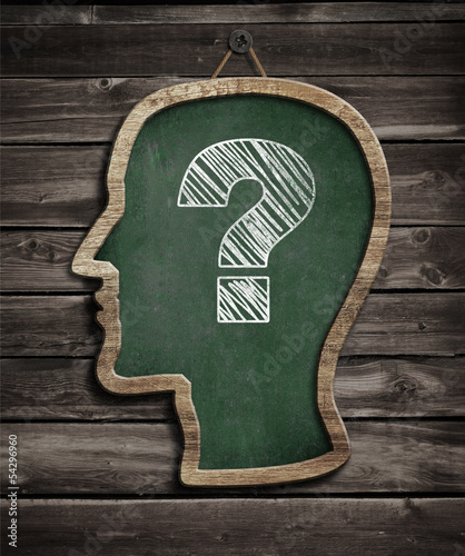 Human head chalkboard with question mark concept