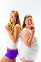 Thin and fat woman holding apple in hand