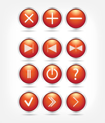 A set of red glass buttons with arrows and math signs