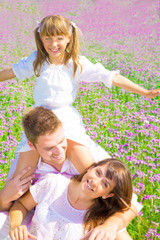 young family on floral texture