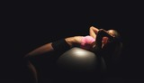 Fitness Woman Doing Workout on a Yoga Ball