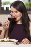 Women drinking wine. Beautiful mature women drinking wine in res