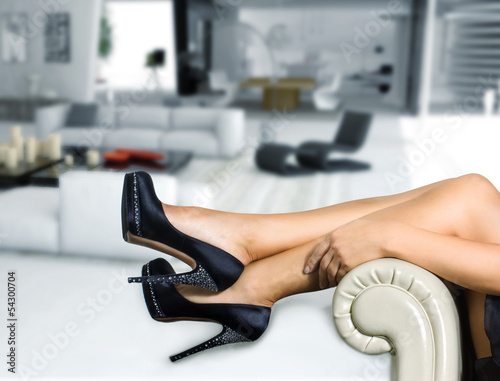 Woman's leg and high heel black shoes