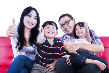 Happy family give thumbs up - isolated