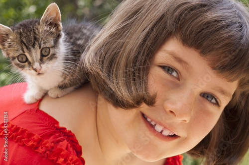 Little girl with cute kitten