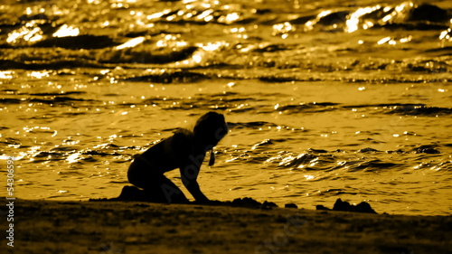 HD - Silhouette of a little girl on the beach