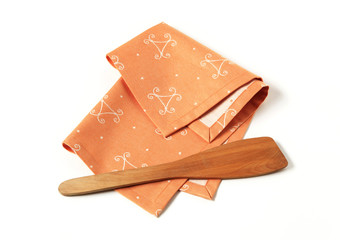 Ornate placemat and wooden spatula
